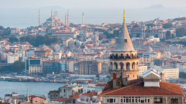 istanbul cityscape with galata tower and mass housing in golden horn, istanbul, turkey - каракёй стамбул стоковые фото и изображения