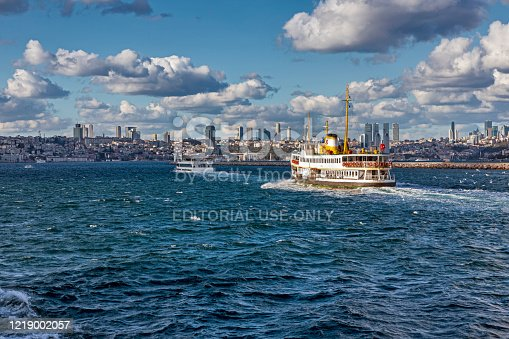 Istanbul, Turkey -  Oct 25, 2018: People are getting on the ferry boat in Kadikoy. Every day nearly 150,000 passengers use ferries in Istanbul.