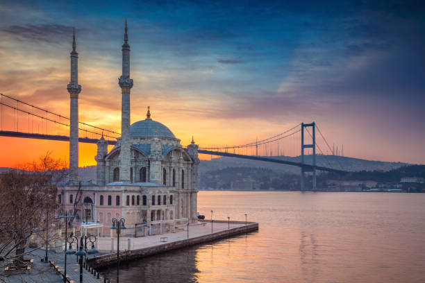 Istanbul. Image of Ortakoy Mosque with Bosphorus Bridge in Istanbul during beautiful sunrise. bosphorus stock pictures, royalty-free photos & images