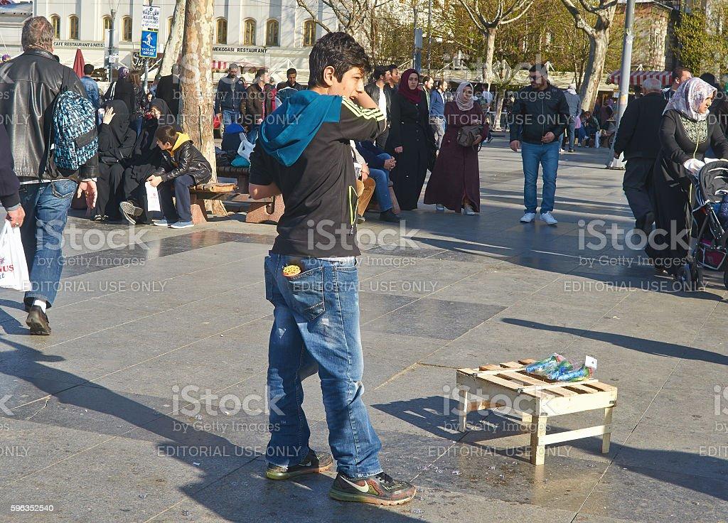 Istanbul, Turkey, April, 03, 2016, Turkish teenager, Eminonu Squ royalty-free stock photo