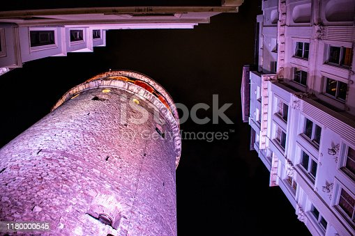 Istanbul, Turkey, Middle East - June 26, 2019: night view of the Galata Tower (Galata Kulesi or Christea Turris), a medieval stone tower built by Genoese in 1348 in the Karakoy quarter, cone-capped cylinder dominating the skyline and offering panoramic vista of the city