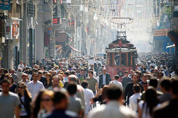 istanbul turkey i̇stiklal avenue tram and crowds - istiklal avenue bildbanksfoton och bilder