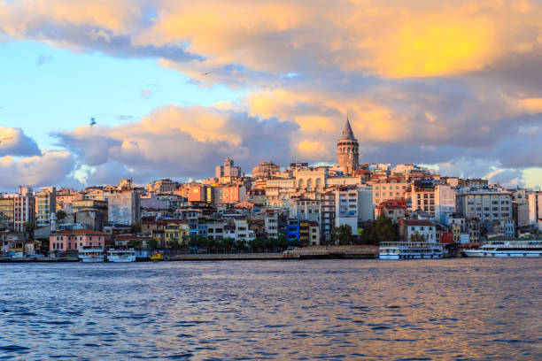 istanbul view across the golden horn with the galata tower in the background - стамбул стоковые фото и изображения