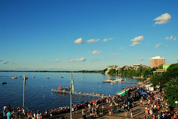 Isthmus Jazz Festival 2014 Madison, WI, USA - June 20, 2014: Many people gather for the annual Isthmus Jazz Festival. The festival occurs at the University of Wisconsin Memorial Union Terrace on Lake Mendota as shown here. madison wisconsin stock pictures, royalty-free photos & images