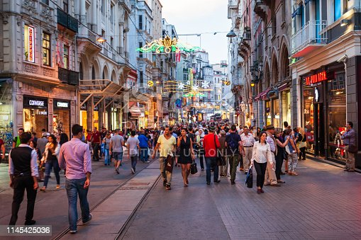 ISTANBUL, TURKEY - SEPTEMBER 22, 2014: Istiklal Avenue or Istiklal Street is one of the most famous pedestrian street in Istanbul, Turkey