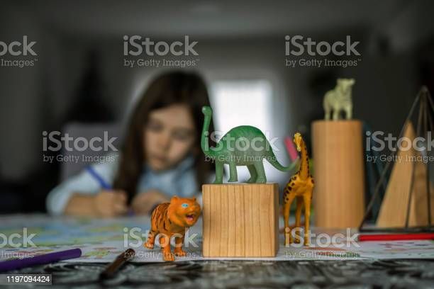Istock photo of a girl drawing and playing with plastic toy animals picture id1197094424?b=1&k=6&m=1197094424&s=612x612&h=siaher 2wg6qtlvhwkoynrgurkih14ljnadfske230m=