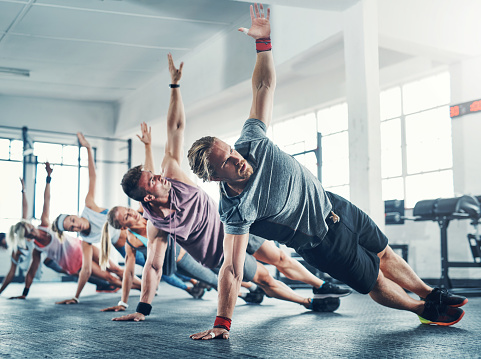 Shot of an accountability group working out at the gym