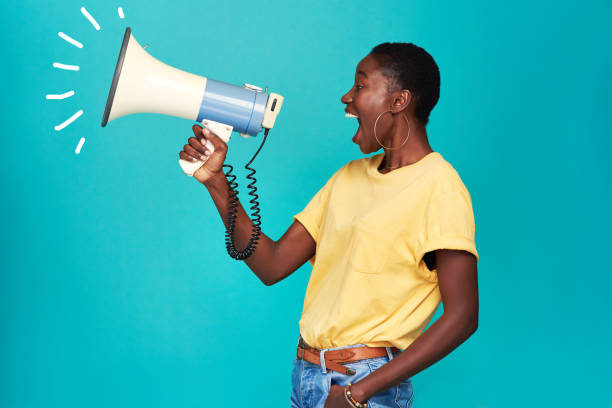 It can take one voice to change the world stock photo
