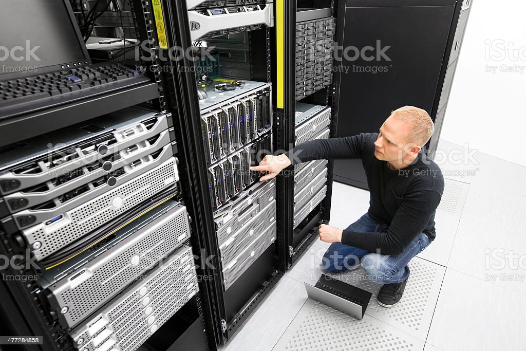 It consultant monitors servers in datacenter stock photo