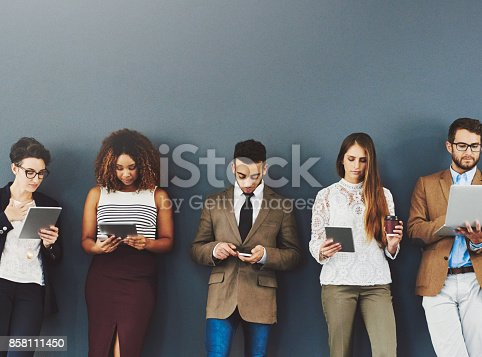 858111468 istock photo It doesn't feel like waiting when you're entertained 858111450