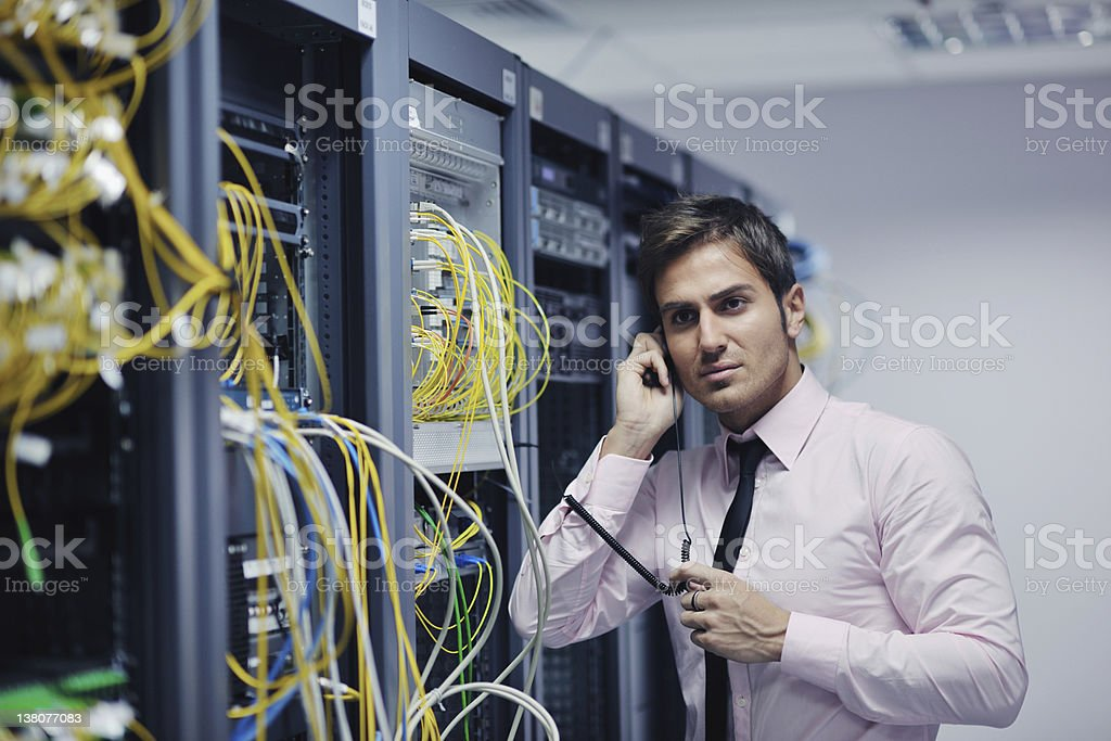 it engeneer talking by phone at network room royalty-free stock photo