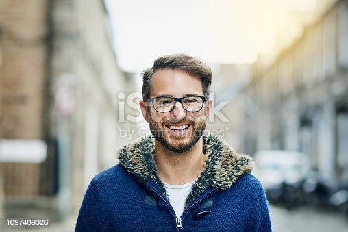 Portrait of a handsome young man outside