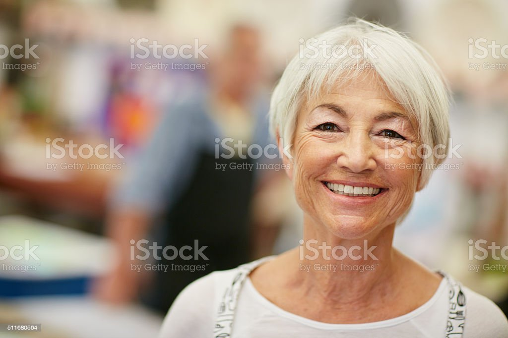 Shot of a senior woman working in a...