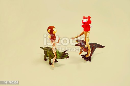 Plastic dinosaurs, joint dolls, animal masks,