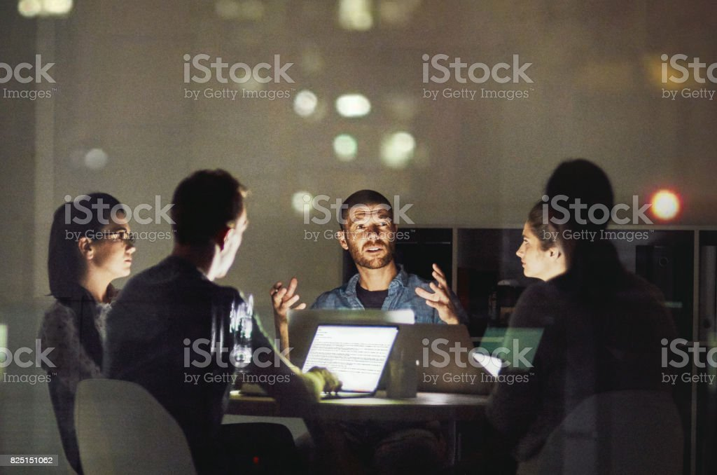 It is great to discuss ideas then bring it to life Shot of creative employees working late in the office Adult Stock Photo