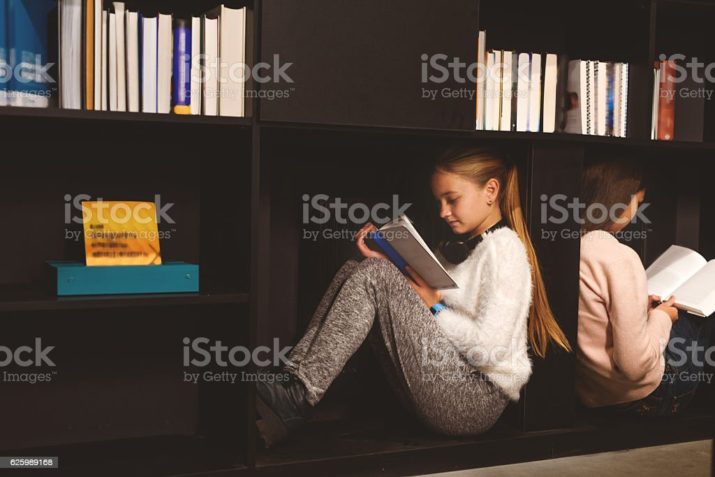 It is more convenient to read in bookcase stock photo
