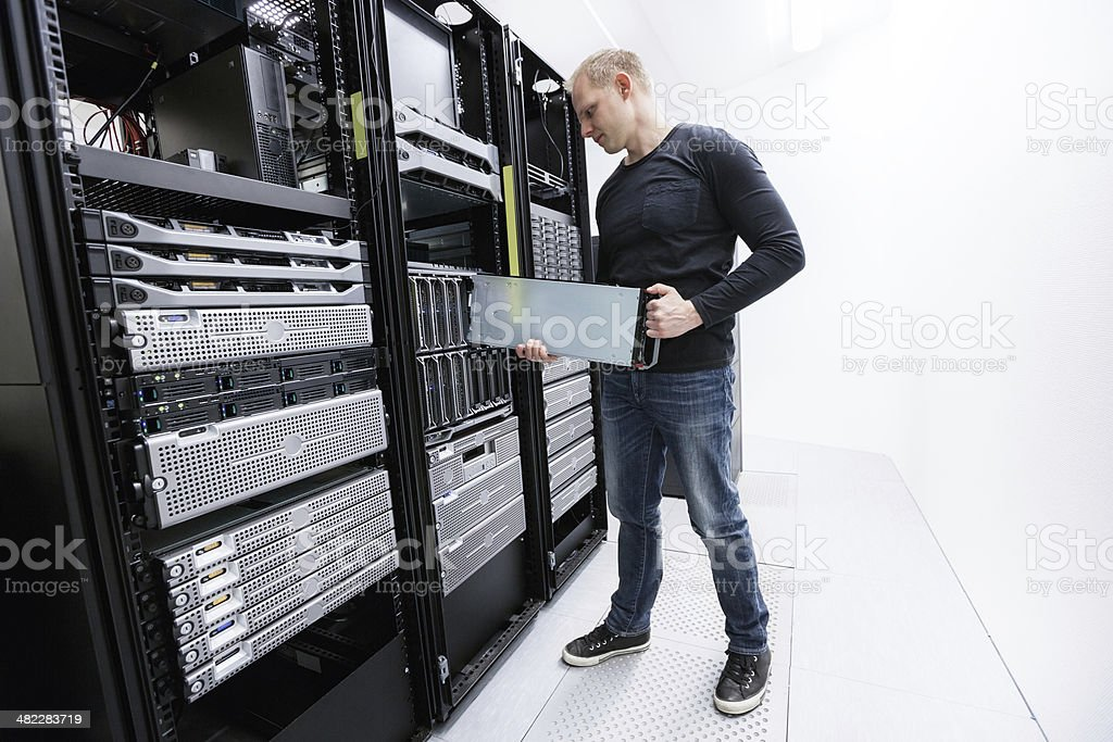 It professional working in datacenter royalty-free stock photo