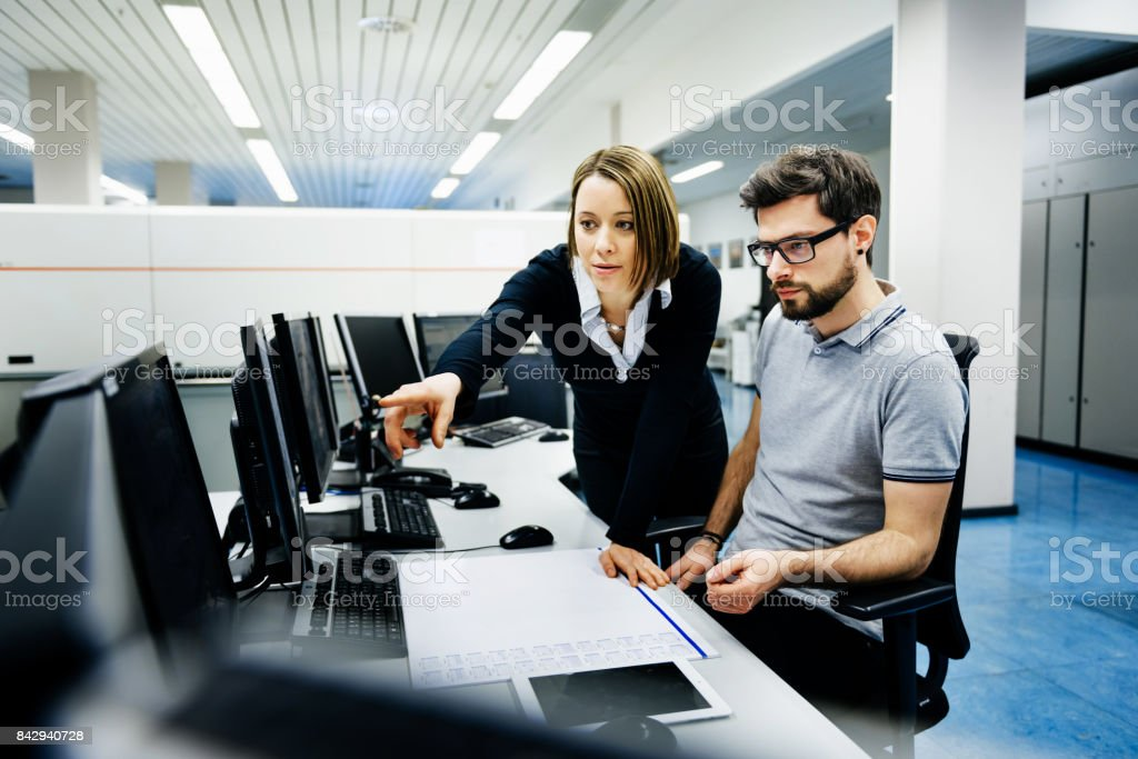 It professionals in control room stock photo