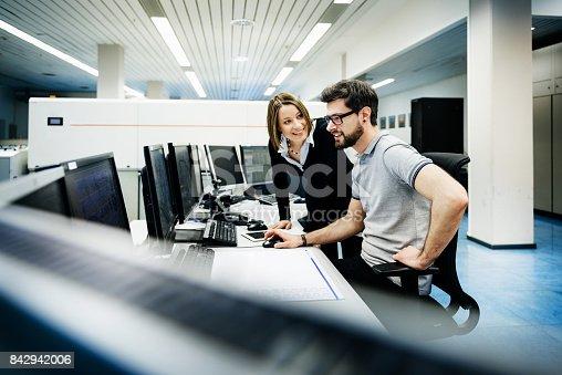 istock It professionals in control room 842942006