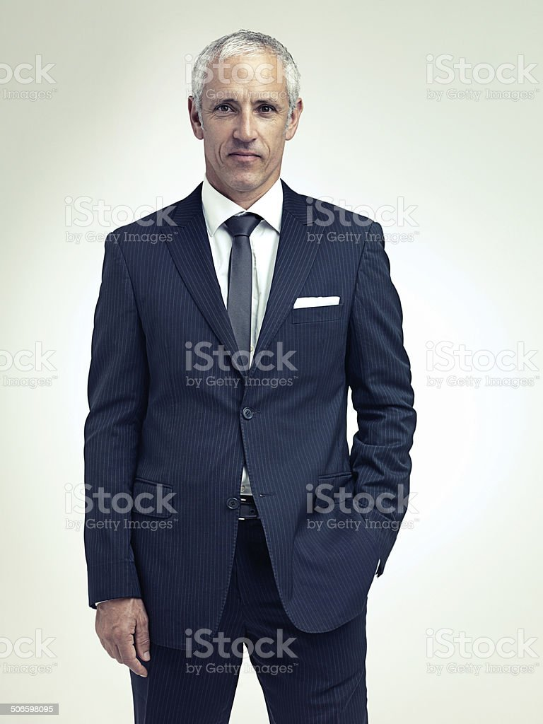 It suits him to be successful A studio portrait of a serious mature man wearing a pinstripe suit 40-49 Years Stock Photo