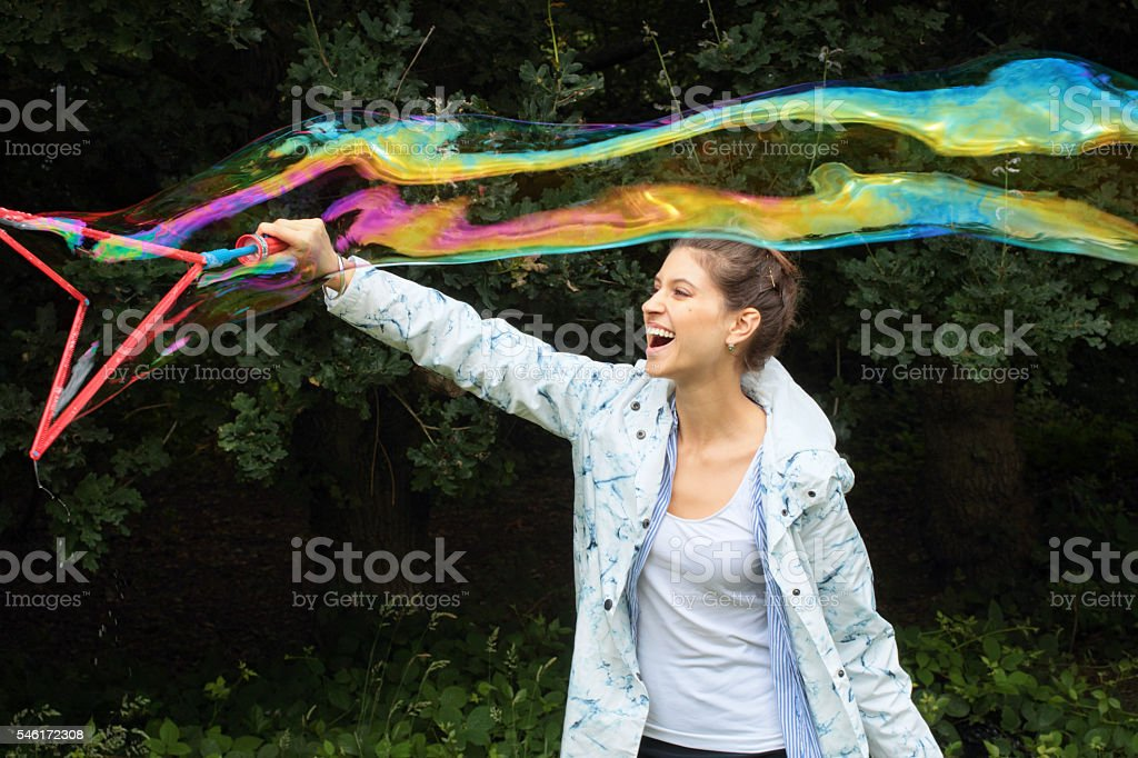 Big bubble fun happy Russian outdoor girl on Mitcham Common stock photo