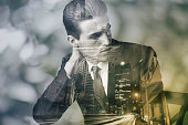 Composite image of a well-dressed man superimposed on an image of a city at night
