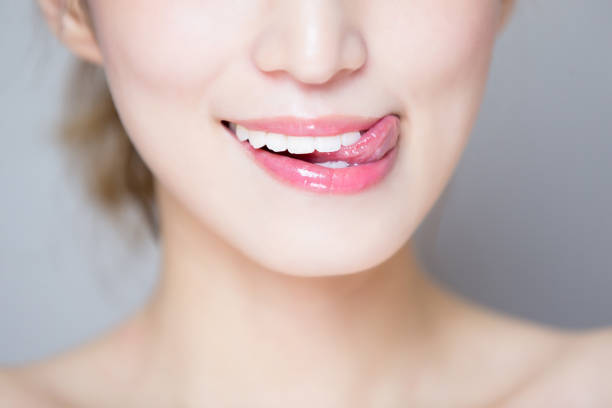 It was delicious close up of beauty woman teeth and tongue licking stock pictures, royalty-free photos & images