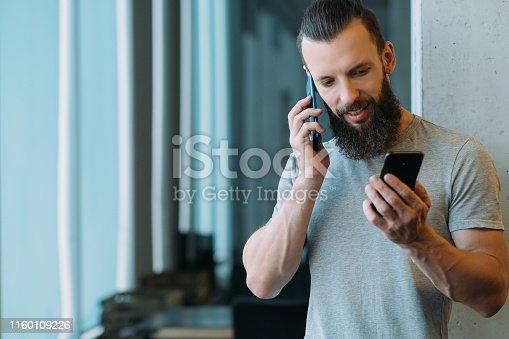 istock it worker corporate lifestyle man smartphones talk 1160109226