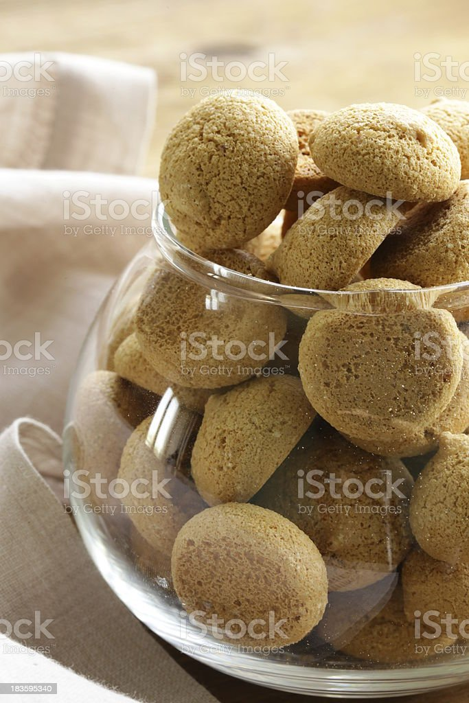 Italian almond amaretti cookies in a glass bowl stock photo