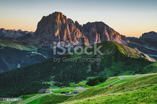 Aerial view of Italian alps - Puez Geisler Nature Park, surrounded by green meadows and mountains.