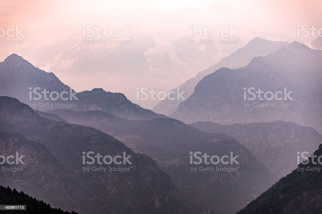 Italian Alps mountains misty landscape stock photo