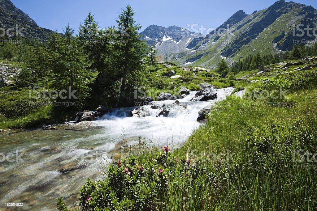 Italian Alps panorama with river royalty-free stock photo
