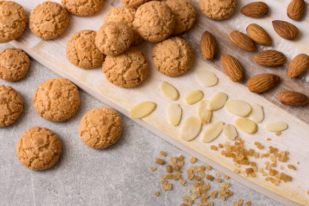 Italian amaretti biscuits. Crunchy almond cookies with sliced and whole nuts and large crystals of brown sugar. stock photo