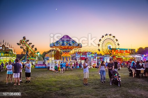 West Windsor, NJ - USA - September 23, 2017: Amusement park rides and plenty of people attended The 18th Annual Mercer County Italian American Festival in West Windsor NJ.