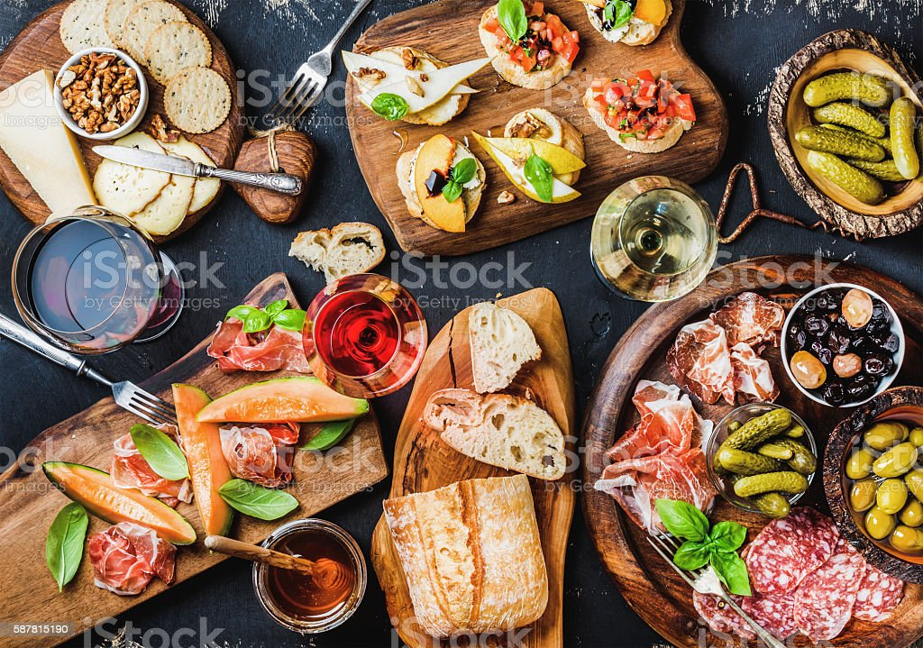 Italian antipasti wine snacks set over black grunge background stock photo