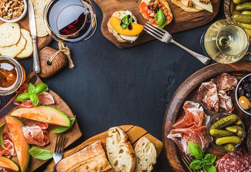 istock Italian antipasti wine snacks set over black grunge background 607267692