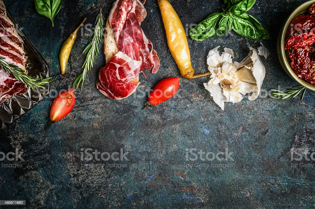 Italian antipasto snack with smoked meat, tomatoes and ciabatta bread stock photo