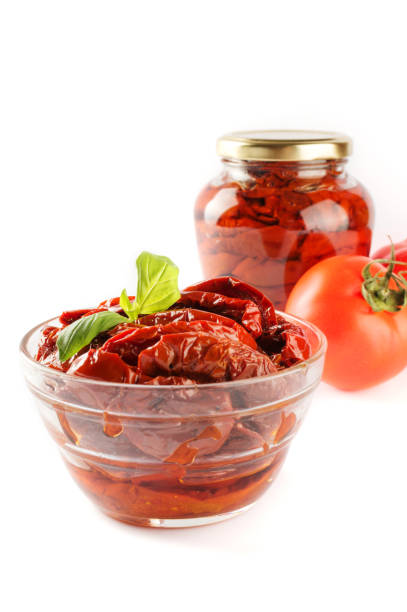 Italian appetizer - sundried tomato in bowl and glass jar