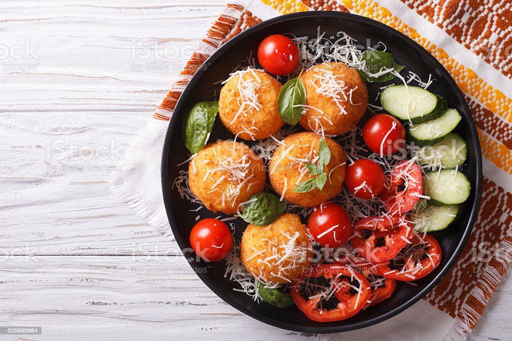 Italian arancini rice balls with cheese. horizontal top view stock photo