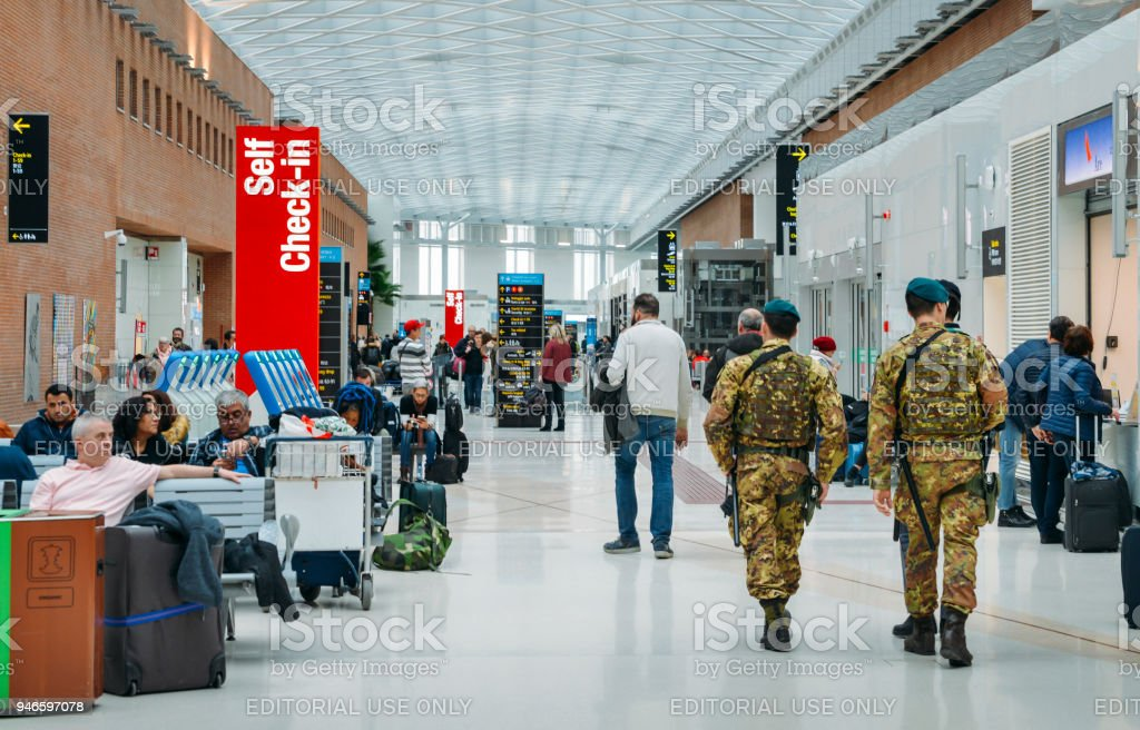 Italian army soldiers patrol the passenger hall at Marco Polo International Airport in Venice stock photo