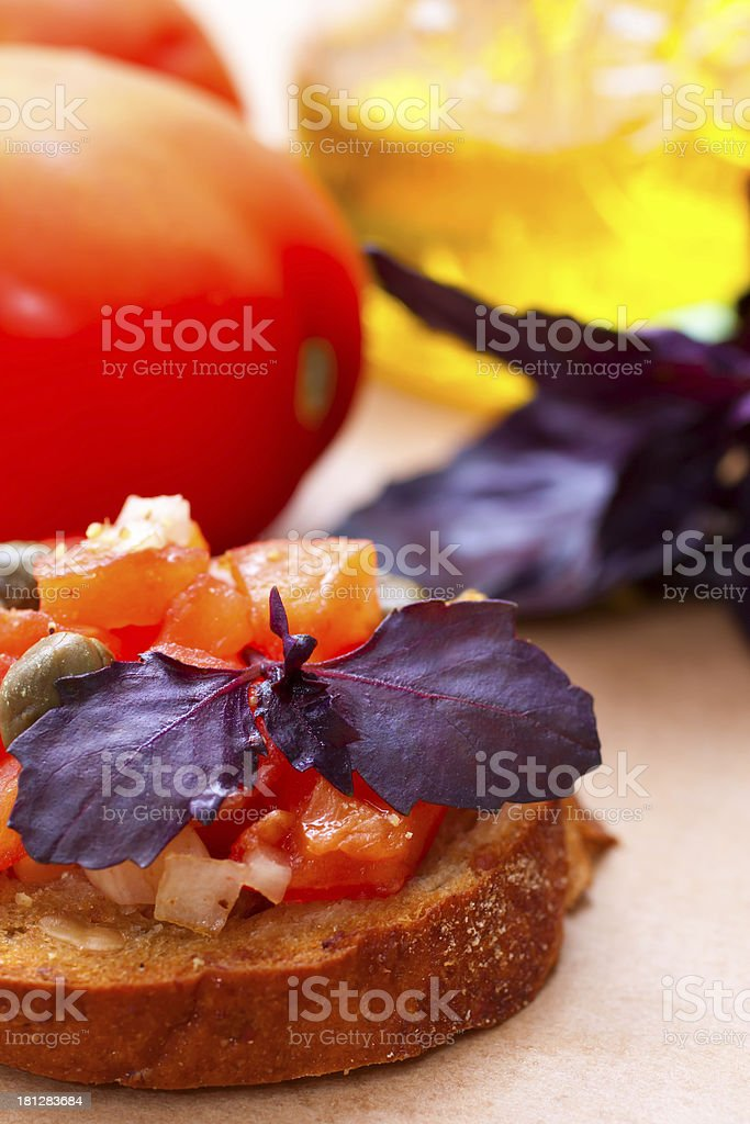 Italian bruscetta with tomatoes, olive oil and basil stock photo
