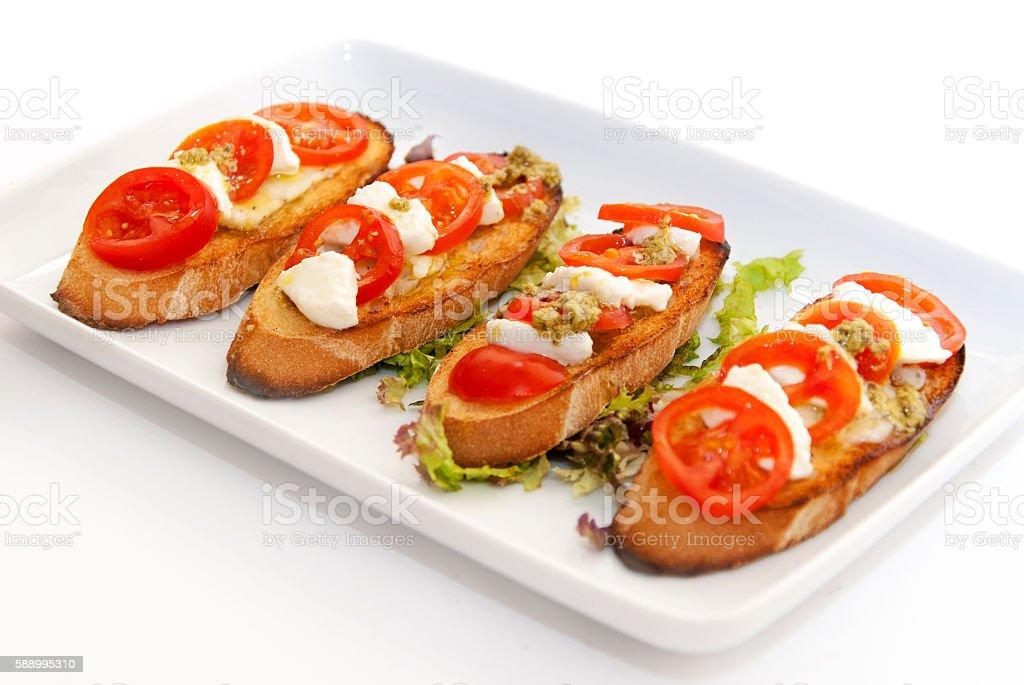 italian bruschetta. Plate with four pieces of fresh Italian Bruschetta. Bread Stock Photo