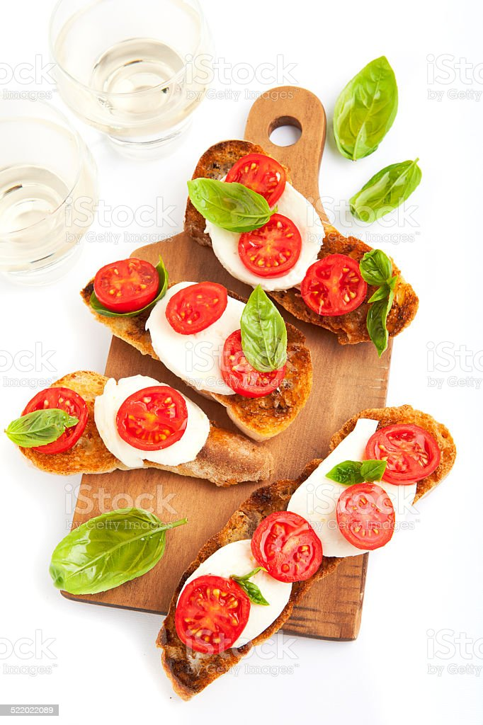 italian bruschetta with cherry tomatoes, mozzarella, fresh basil stock photo