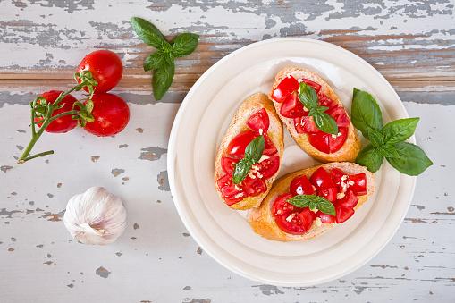 Italian bruschetta with tomato, basil and garlic on a plate