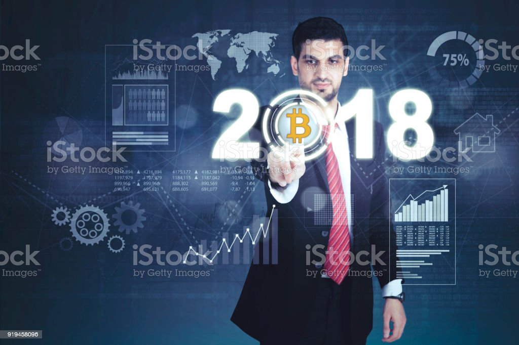 Italian businessman pressing bitcoin symbol stock photo