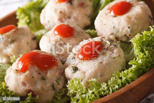 istock Italian canederli with tomato sauce on a plate macro. horizontal 522853948