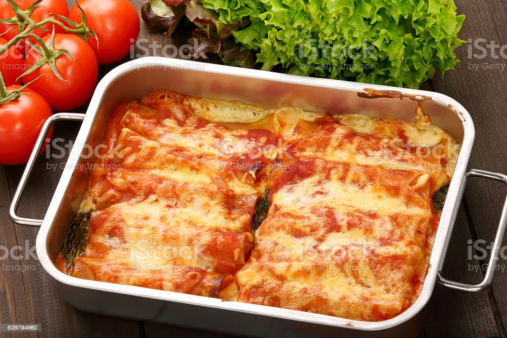 Italian cannelloni baked in a bowl stock photo