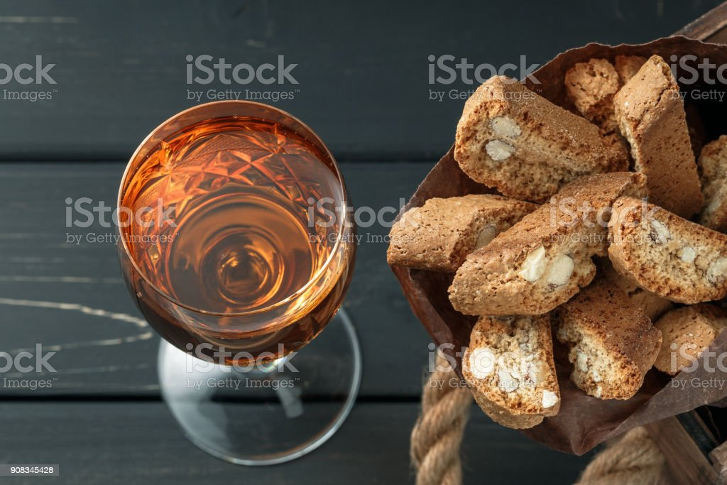 Italian cantucci biscuits and a glass of wine stock photo