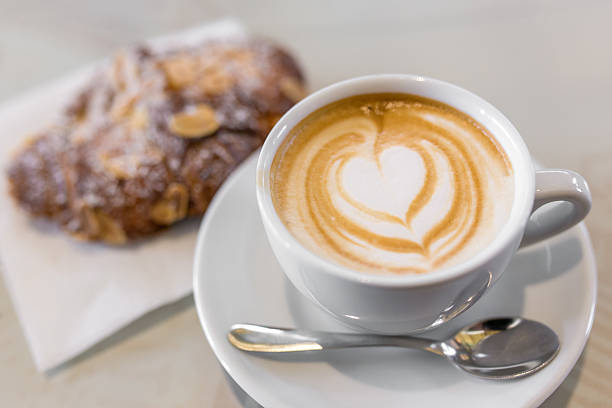 Italian cappuccino with fresh almond cornetti stock photo