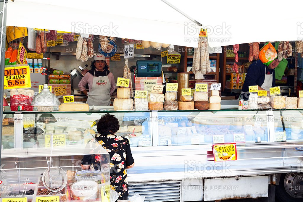 Italian cheese market stall stock photo